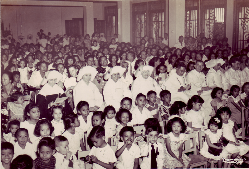 Kindergarten graduation -1949   I'm the kid in front with the white shirt and black tie.