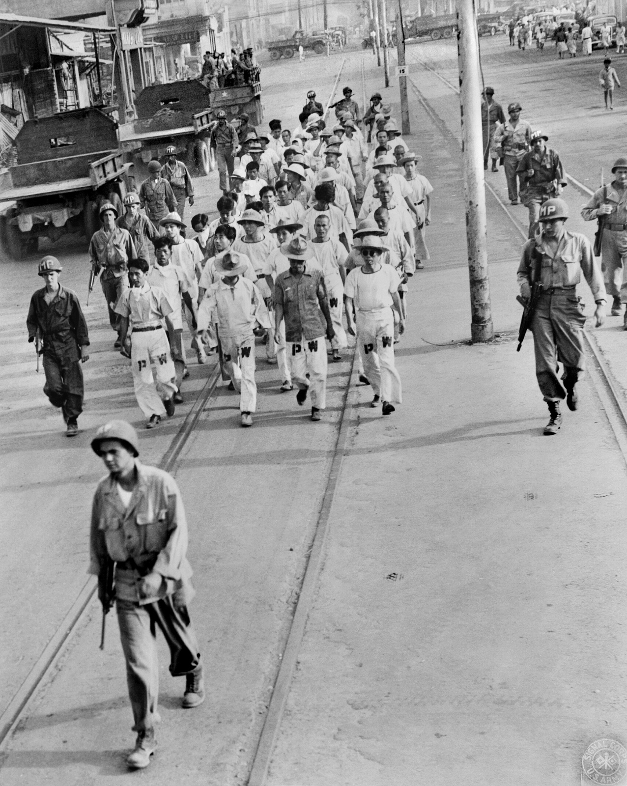 Immediately after liberation, GIs wal Jap POWs down Rizal Ave-1945