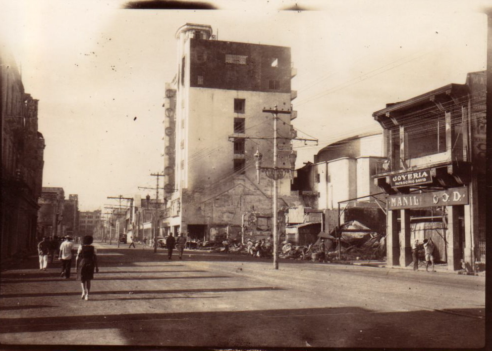 Rizal Ave. looking south with the Avenue Theater on the right -1945