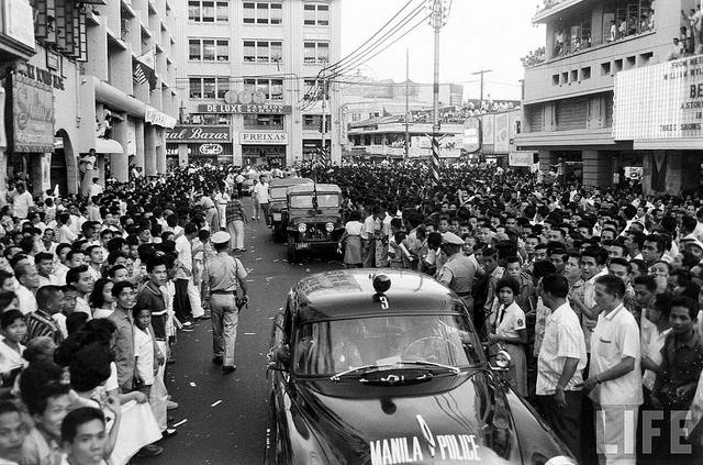 Crowds surge against Ike's motorcade during his visit -1960