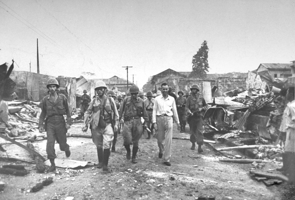 Internee Ernest Stanley leading Japs out to neutral area outside of Santo Tomas