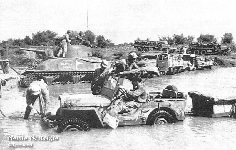 Bob Holland stuck in his jeep while the rest of the 1st Cav wait patiently. Battlin' Basic is in the background