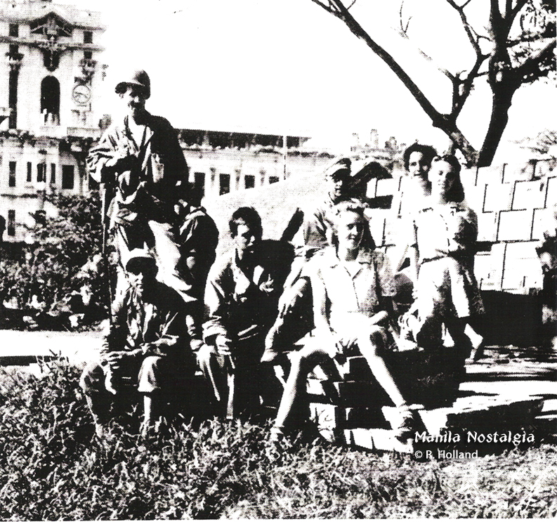 Bob Holland (standing on left) with internees and friends from the 1st Cavalry.