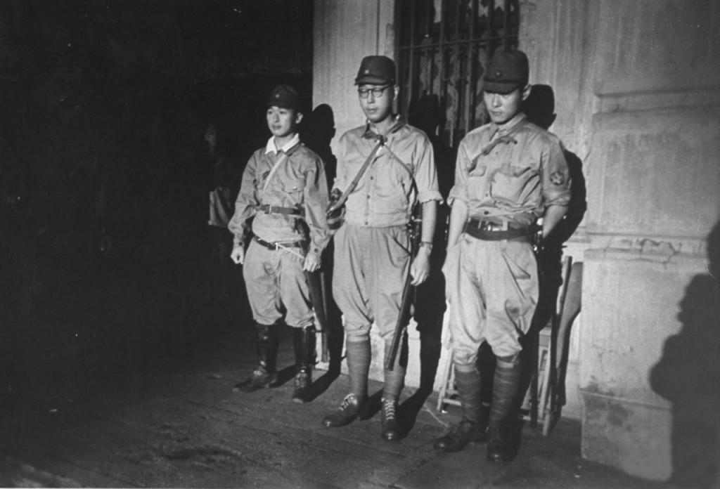 Japs guarding the Education Bldg. during hostage negotiations