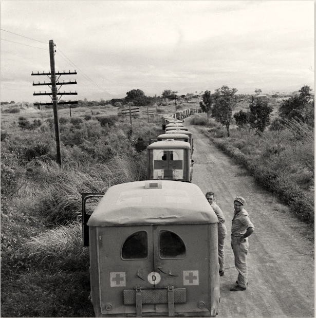 Long line of ambulances wait for the internees arrival. [Life ©Mydans]