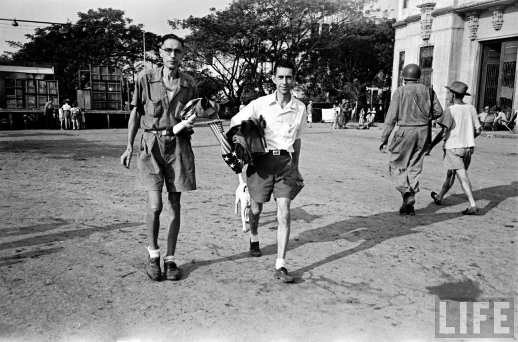 Civilians cart their meager belongings after liberation