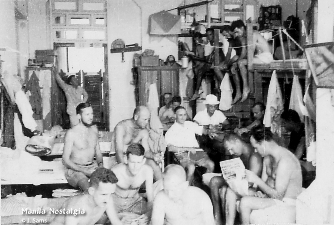 Men's dormitory room packed with internees - taken by Jerry Sams during confinement.