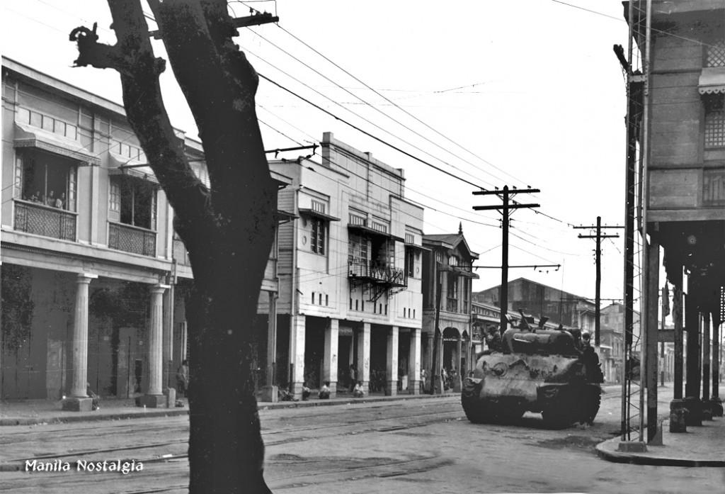 American tank rumbles down Manila street