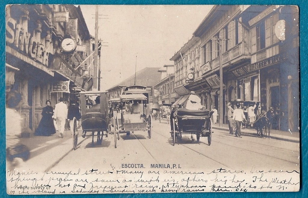 Great shot of the Escolta showing the variety of horse carriages. c, 1890
