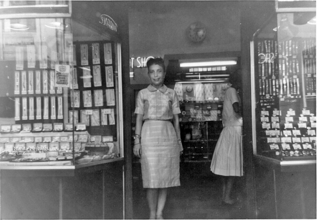 My mom, Carlota, in front of our store Gem Gift Shop on the Escolta.