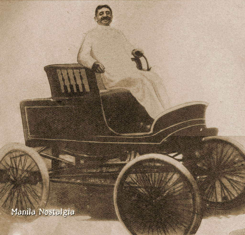 Bachrach seated in one of the first cars imported to the Philippines.